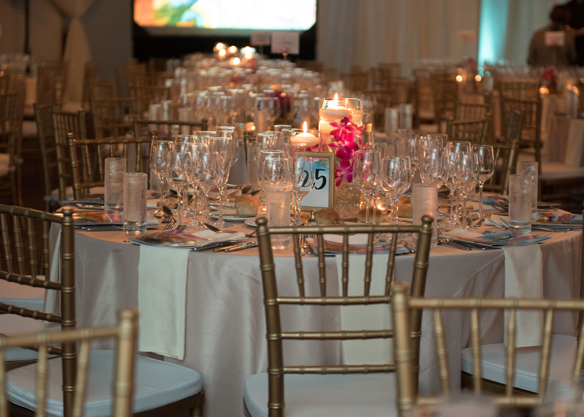 Photo of main ballroom table with pink flowers and candle center pieces.
