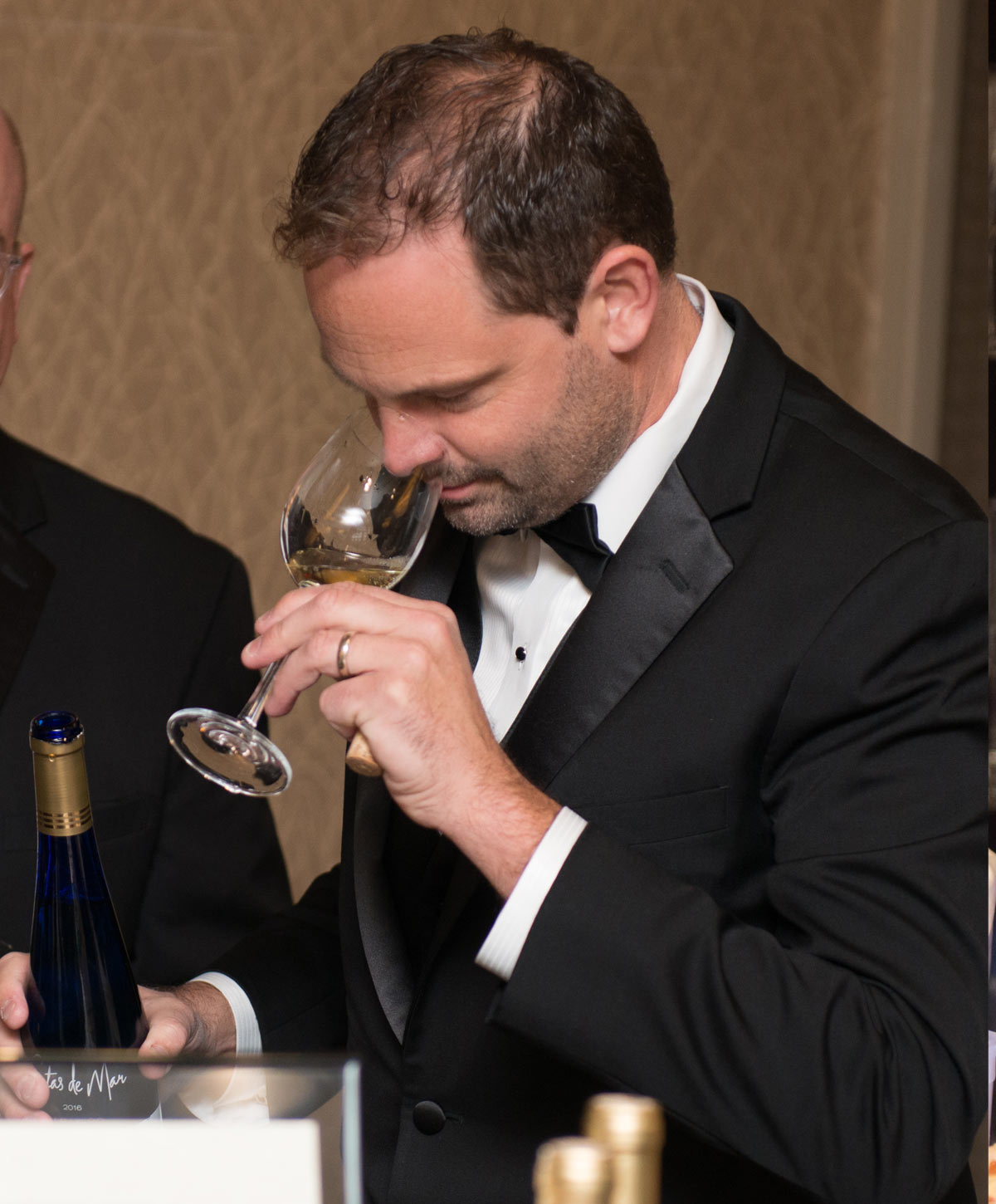 2017 Gala winemaker smelling wine.